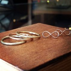 14k gold stardust stackable bands and 14k rose gold infinity studs