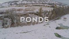 Aerial Shot Frozen River Hills Trees Field Barn Ice Winter Snow Drone Footage - Stock Footage   by RyanJonesFilms