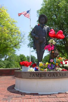 James Garner's statue in Norman, Oklahoma along Main Street (James Gardner Corridor). Flowers and tributes left by family, friends and fans. (7-22-14)