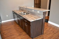 Formica 180fx Dolce Vita on lower level and granite on upper level.