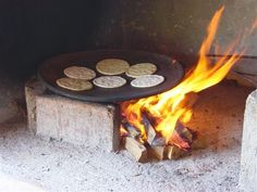Making tortillas in a real comal.