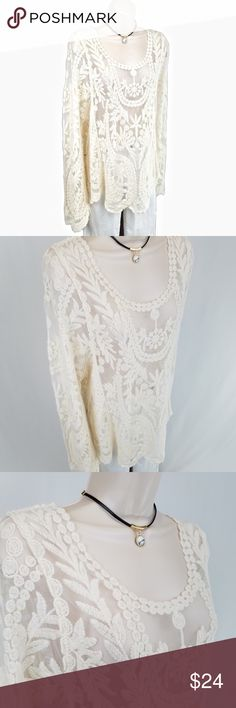 Ivory lace top w/ scalloped hem Long sleeved boat neck ivory lace top / tunic with scalloped hem and cuffs.    Bust ~23 / length 26 inches.  65% cotton, 35% polyester. Simply Couture Tops
