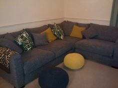 DFS Dillon grey wide corner sofa, H&M plant pillows, knitted pouffes