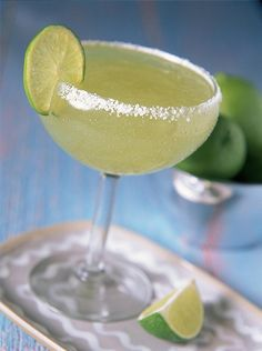Margaritas Made With Limeade - Minute Maid Limeade with a shot each of tequila ande triple sec and one slice of fresh lime