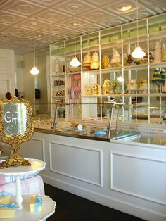 Putting shelves on the wall behind the counter and using it to display dummy cakes. REALLY great use of a small space!