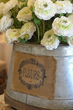 Burlap, Zinc and White Flowers...Because I Love Shabby French Country Charm! See thefrenchinspiredroom.com for more!