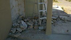 """the rock facade I took down- it was coming off in some spots and very badly """"grouted"""" between the rocks, a real mess, it had to go. I might redo something like it,"""