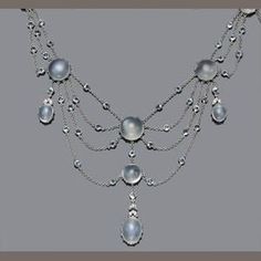 A moonstone, aquamarine and diamond swag necklace