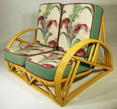 Vintage barkcloth cushions on rattan settee. Nice for a screened-in porch.