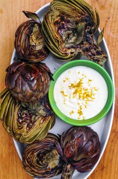 I've been in Los Angeles for a week and we've already grilled artichokes three times. While the earth in my neck of the woods back east still snores through its winter slumber, agriculture is full-on here. Given the warm weather, we decided to grill as much as possible so we've been finishing off the 'chokes on the grill. It lends a nice crispy texture to the edges (think potato chip!) and a smoky flavor that you just can't get out of a pot of boiling water.