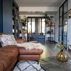 How well do these colours work together in this living room. Love the blue/grey paint on the doors and bookshelves, brown leather sofa and monochrome rug. Paint Colors For Living Room, New Living Room, Living Room Furniture, Brown Leather Sofa Living Room Decor, Pallet Furniture, Grey And Brown Living Room, Up House, Living Room Designs, Instagram