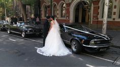 Mustangs in Black 1970 Mach 1 Fastback and 1967 GT Convertible Ford Mustangs out for Sonia and Tim's wedding shoot.
