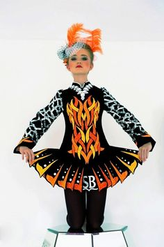 the head piece is whack-a-doo, but N. would love this flaming dress