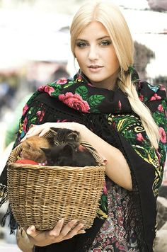 Pretty girl with a basket of kittens wears a Russian Pavlovsky Posad shawl.