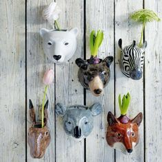 Decorating your wall with ceramic animal planters. Love these! // Plants, Flowers, Vertical Spaces