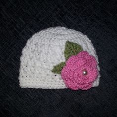 Crochet baby hat with flower.