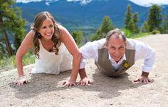 Colorado Mountain Wedding Photography - Bride and Groom having a push up contest - Fun couple's photo idea  http://www.raynamcginnisphotography.com/sneak-peek-sapphire-point-wedding-photography-jen-and-dan/  Sapphire Point Overlook, Sapphire Point Wedding Photographer