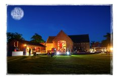 Southwood Hall at nigh time during a wedding. Southwood Hall Weddings - Norfolk and Norwich Wedding Photographer - Tim Doyle Photography