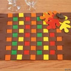 Let your children pitch in to thanksgiving dinner by having them create these cute placemats for your guests!