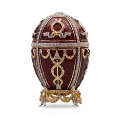 """Bordeaux Arrow Faberge Style Musical Egg - This wonderful egg/music box is made in the style of the famous first Faberge egg, called the """"Rose Bud,"""" crafted by Karl Faberge in 1895 for Emperor Nicholas II, who gave it to his wife, Empress Alexandra."""