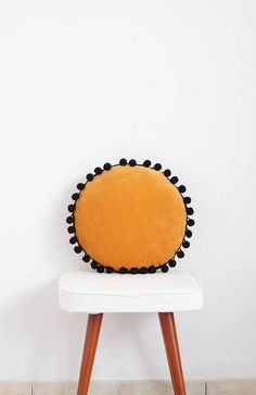 This is super delicate and soft round pillow made of softest polish cotton velvet and embellished with black pom pom trim. It brings originality, coziness and a bit boho style to every room. This antyallergic cute cushions are ideal add-ons to kids rooms and nurseries. Colour: Mustard