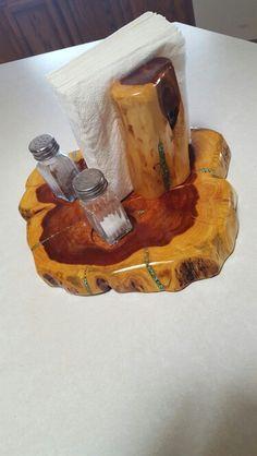 Cedar log napkin holder with inlayed turquoise.