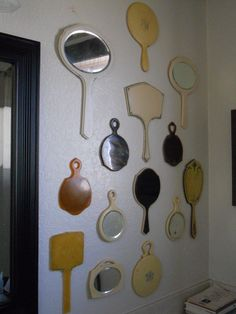 """Someone's collection of celluloid mirrors.  Celluloid was used before plastic was invented.  Probably a lot safer.   """"The first so called plastic based on a synthetic polymer was made from phenol and formaldehyde, with the first viable and cheap synthesis methods invented in 1907, by Leo Hendrik Baekeland, a Belgian-born American living in New York state.""""  Wiki"""