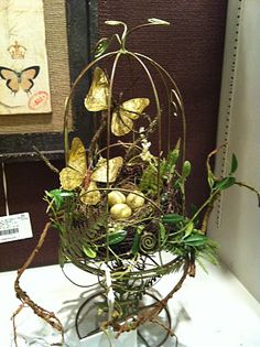 Cage with butterflies and a bird's nest. I must make this but I will add some spring flowers.
