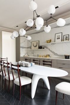 sculptural table & chairs in this very modern dining room