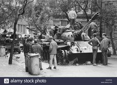 Prague, Czechoslovakia. End of the Prague Spring, a period of political liberalization in Czechoslovakia during the era of its domination by the Soviet Union after World War II. Czech children playing on a burnt out Russian tank. August 1968.