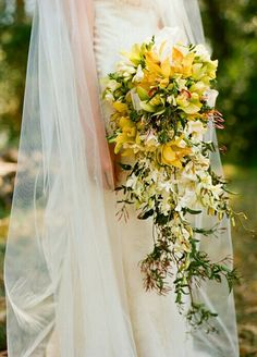 Gorgeous Cascading Bridal Bouquet Which Includes: Yellow Cymbidium Orchids, Lime Green Cymbidium Orchids, White Dendrobium Orchids + Buds, Several Varieties Of Greenery & Foliage