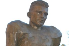 """This larger-than-life statue honors Charlie """"Choo Choo"""" Justice, twice a runner-up for the Heisman Trophy while piling up yardage as an elusive running back at Carolina in the late 1940s."""