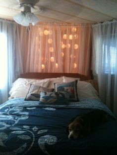 Put string lighting behind sheer curtains against a dark backdrop and voila!  Magnificent mood lighting perfect for a bedroom