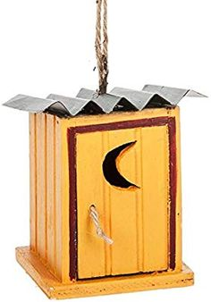 5979a561fc5 Amazon.com  Midwest-CBK Yellow Outhouse with Tin Roof Funny Christmas  Holiday Ornament