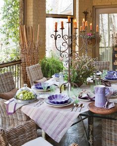 Lavender takes the lead on this tabletop, accented with green glassware that plays off the scene's surrounding verdant views. #southernladymag #tablescape #tablescapes #tablescapestyling #tablestyling #styling #tablescapetuesday #tabletoptuesday French Country Style, French Country Decorating, French Chic, French Cottage, Cottage Style, French Farmhouse, Georgian Style Homes, Higher Design, French Countryside