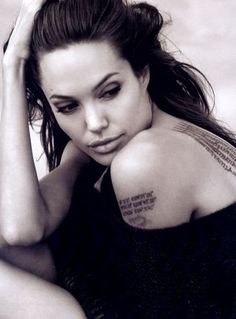 tough because of the tatoo's but still very feminine, love it. Angela jolie