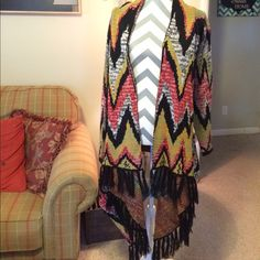 Sweater wrap* Like new condition. No snags or piling. Worn once.size medium but I wear a large and it works perfect for me😉 Woven Heart Sweaters Shrugs & Ponchos