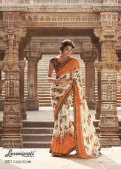 This abstract color combination cream- orange on this satin georgette saree with elegant rose flower prints.