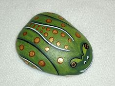 LEOPARD FROG, endangered species, hand painted rocks, pond or patio decor. $30.00, via Etsy.