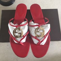 Gucci (ON HOLD) Red Gg Cage Flat Thong Sandal These are cute for summer, they still have miles to go. Sold out in store completely. Ok condition, normal wear on soles & small scuffs on front. Lipstick Red. Come with original box! Gucci Shoes Sandals