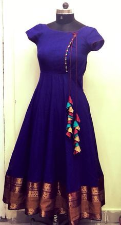 Beautiful royal blue color floor length anarkali dress with multi color tassels. Beautiful royal blue color floor length anarkali dress with multi color tassels. Salwar Designs, Kurti Designs Party Wear, Kurta Designs Women, Saree Blouse Designs, Long Dress Design, Dress Neck Designs, Neckline Designs, Kalamkari Dresses, Ikkat Dresses