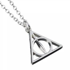 Showcase your love of all things Harry Potter, whilst making a bold fashion statement with this unique silver deathly hallow necklace. The perfect accessory for your stylish daytime looks. Deathly Hallows Necklace, Harry Potter Films, Bold Fashion, Necklace Online, Silver Necklaces, Fans, Stylish, Unique, Earrings