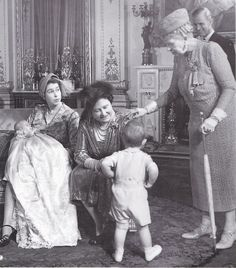 Princess Anne's christening; Four generations of royals - Queen Mary, Queen Mum, Queen elizabeth, and Princess Anne.  That's Prince Phillip in the background with Prince Charles' back to the camera. 1950
