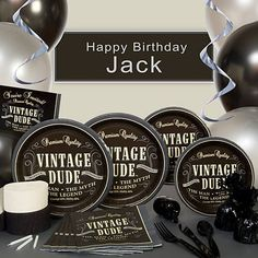 The Vintage Dude Party Supplies feature a black and gray design with the look of a whiskey bottle label.