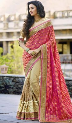 Women splendor is magnified tenfold in this type of a alluring beige and pink color banarasi silk embroidered half n half sari. The ethnic crystals and butta work at the clothing adds a sign of attractiveness statement with your look. #OutstandingDesignOfPartyWearSaree