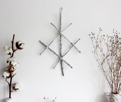 Protection . Wall hanging viking rune with white twigs .
