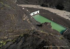My favorite swimming pool in Seljavellir, Iceland, after the Eyjafjallajökull eruption in 2010