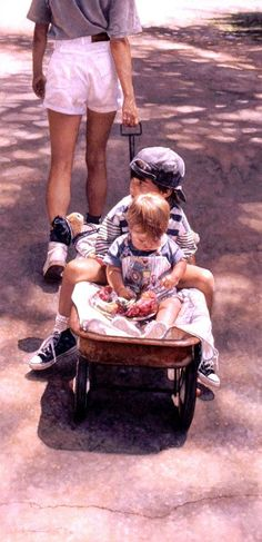 Steve Hanks.  Reminds me of growing up in the 1940s and 1950s.  My cousin Ron and I were always pulling each other around in his wagon. -Penny-