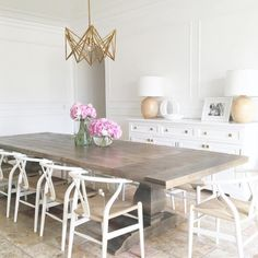 """Really feeling this light, bright + uncluttered space this Monday morning. Today as part of our """"best of blog"""" series we are featuring lighting -- entry, dining, kitchen pendants and sconces. Head to Beckiowens.com for all the details + picks. #cidoproject collab with @nicoledavisinteriors"""