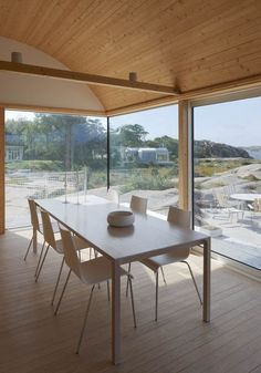 Summer house on stilts by Mats Fahlander nestles into a Swedish fjord Warm Dining Room, Dining Rooms, Dining Table, Dining Chairs, Small House Swoon, Swedish Cottage, House On Stilts, Interior Architecture, Interior Design